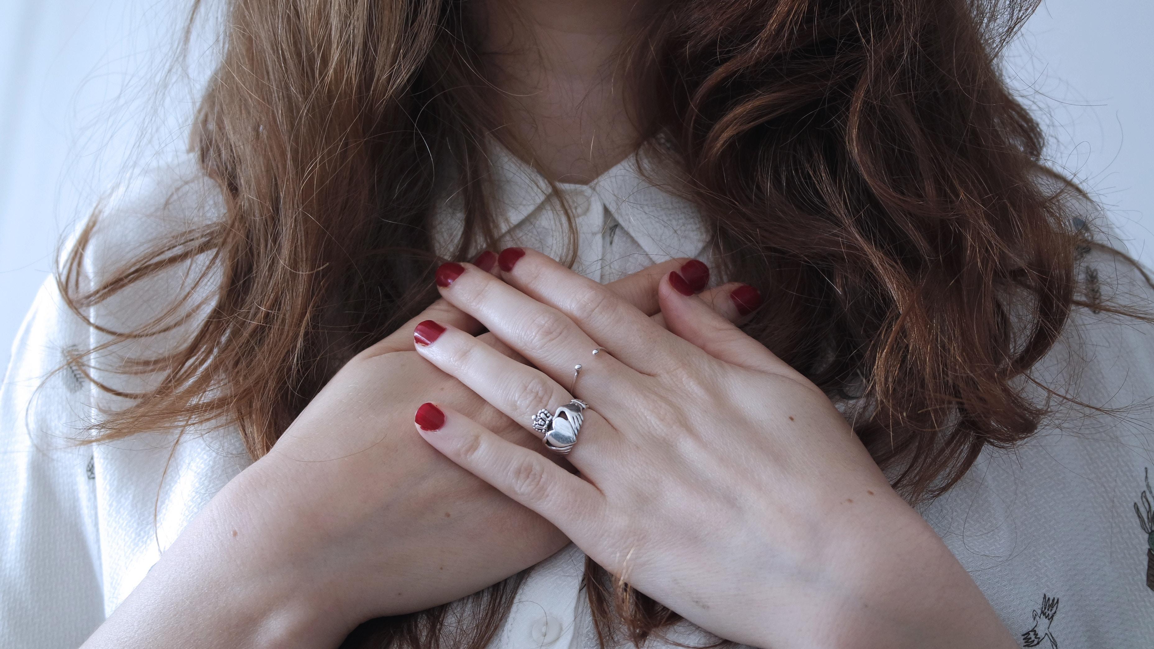 alt=woman covering chest, alt=open heart